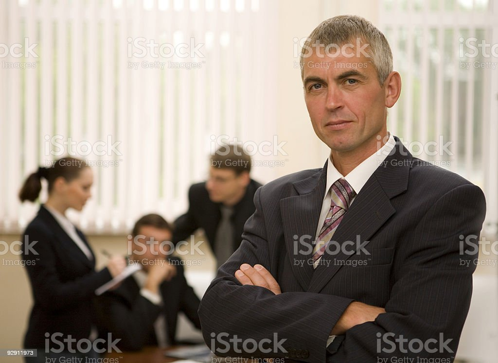 Successful senior businessman with his teamwork in the office. royalty-free stock photo