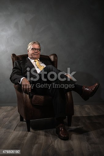 istock Successful senior man relaxing in an armchair 479305192