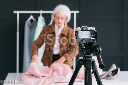 672064598istockphoto successful senior woman fashion lifestyle blogging 1132787386
