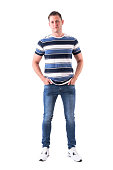istock Successful serious man in casual clothes posing and looking at camera with hands in pockets 1065864092
