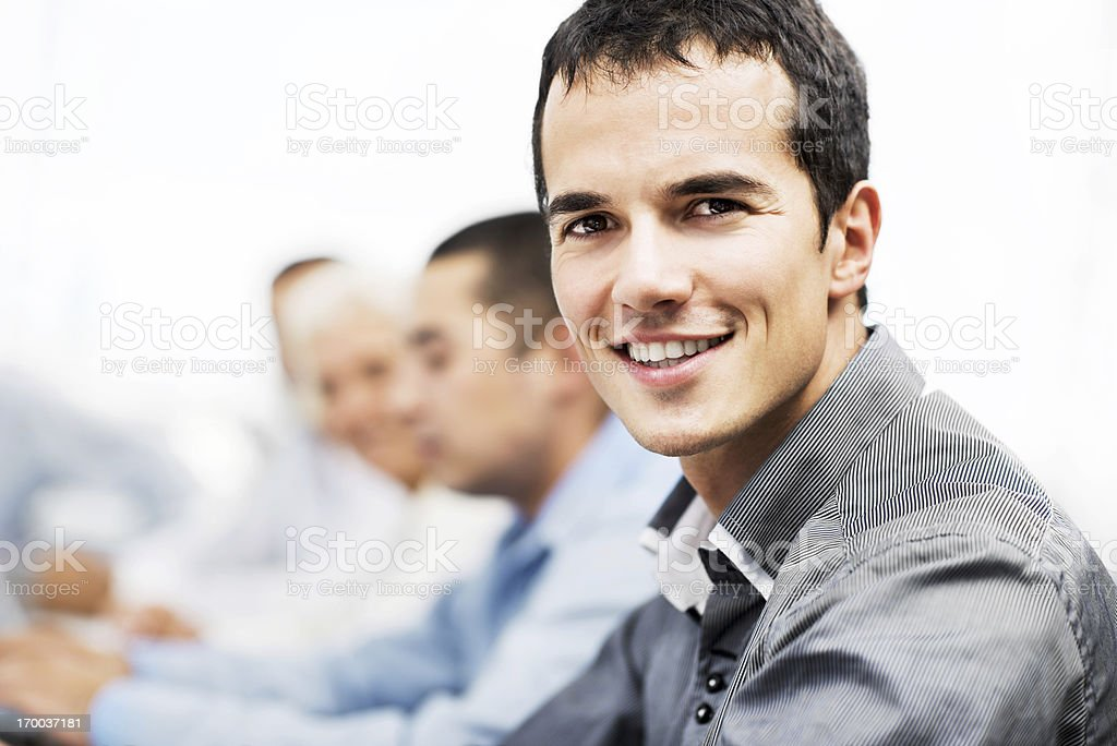 Successful smiling man on a meeting royalty-free stock photo