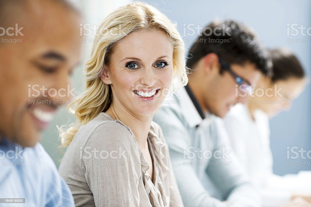Successful smiling woman on a meeting. stock photo