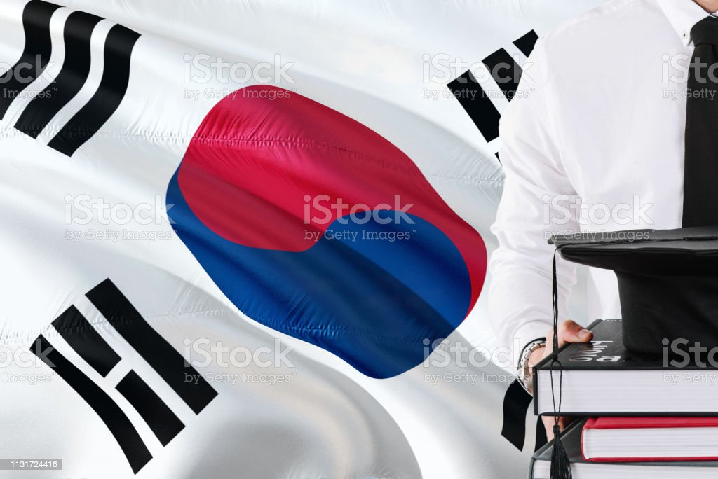 Successful South Korean Student Education Concept Holding Books And