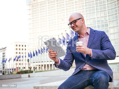 Portrait of successful businessman dealing with EU funded project and policies from Headquarters of European Commission based in Brussels in Belgium