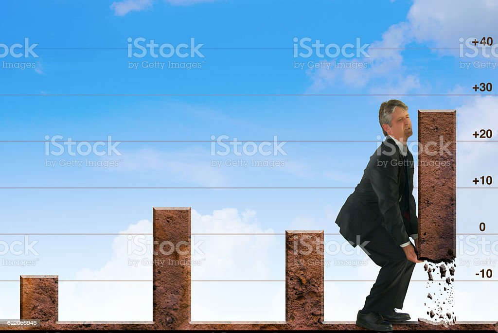 Successful stock market advice man forcing graph bar up stock photo