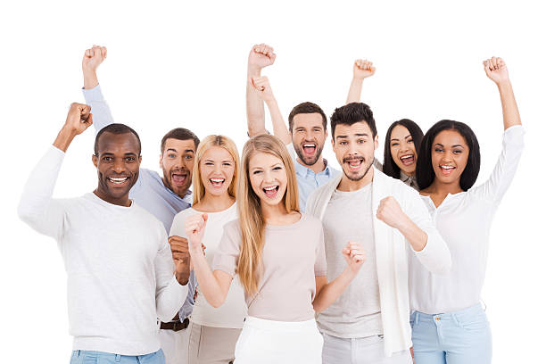 Successful team cheering with fists in air stock photo