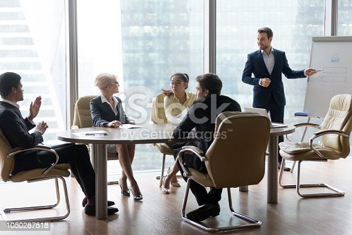 istock Successful team leader businessman boss presenting new project 1050287518