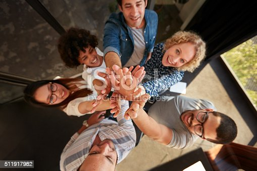 istock Successful team of professionals high fiving 511917982