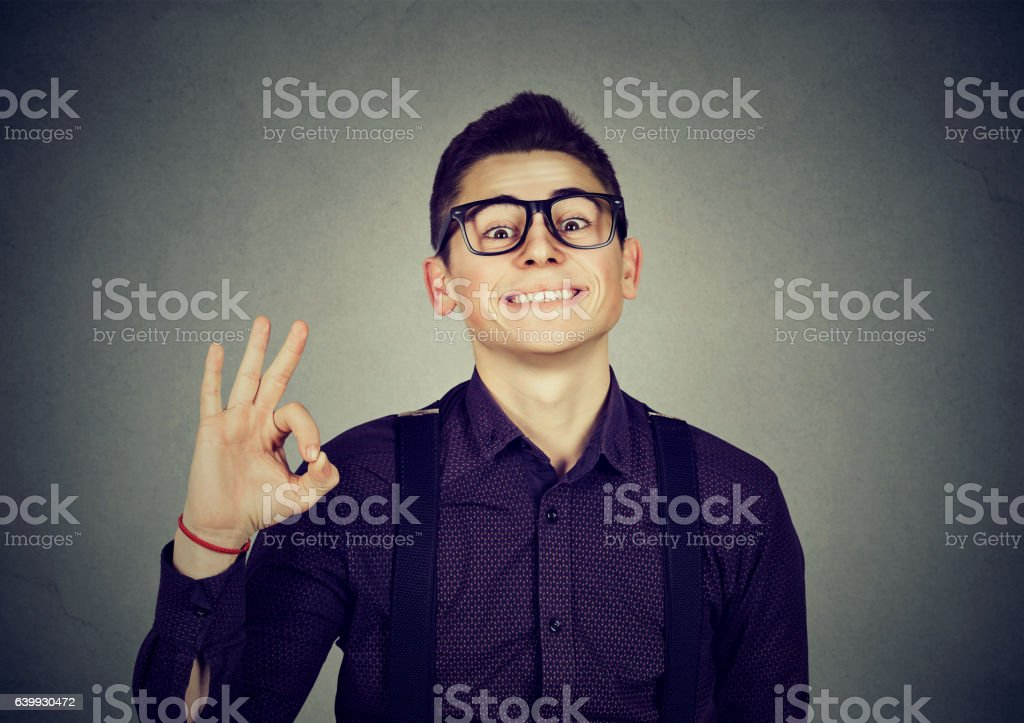 Successful teenager with ok sign stock photo
