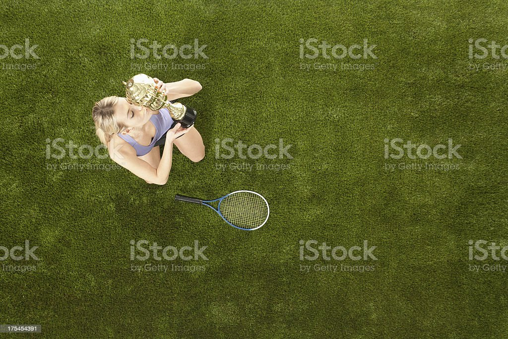 Successful tennis player with her trophy royalty-free stock photo