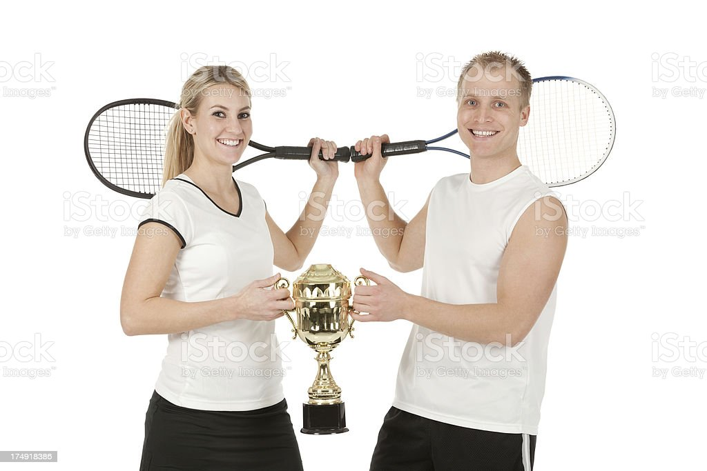 Successful tennis players with their trophy royalty-free stock photo