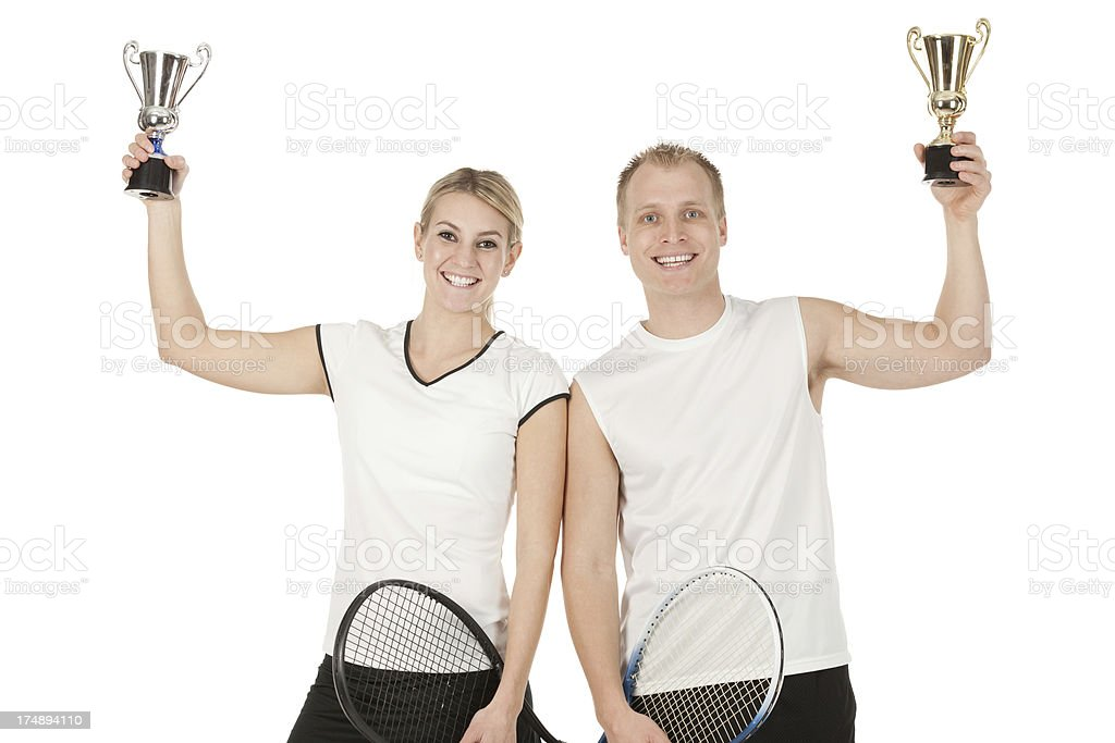Successful tennis players with trophies royalty-free stock photo