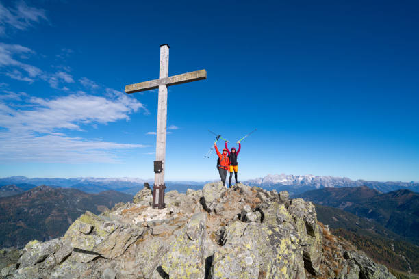 successful very happy hiking couple together on mountain peak high up in european alps stock photo