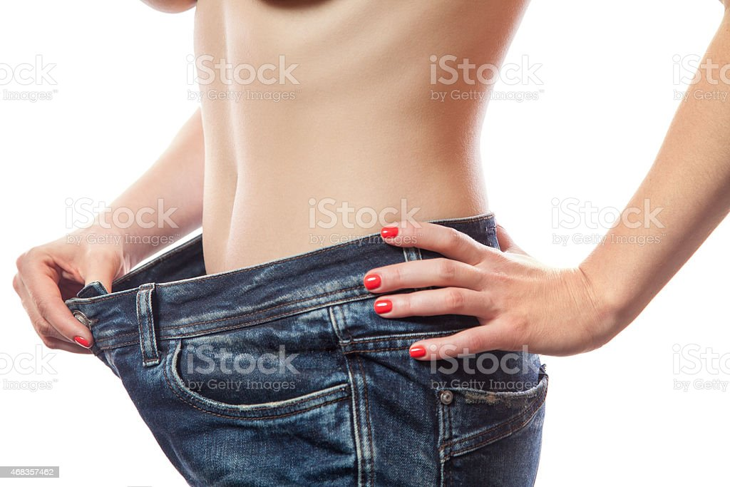 successful weight loss, white background, diet concept royalty-free stock photo