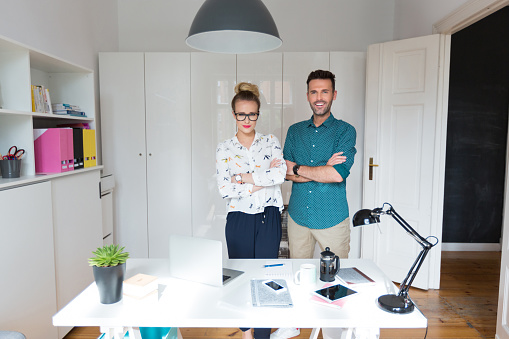 Successful Woman And Man In An Office Stock Photo - Download Image Now