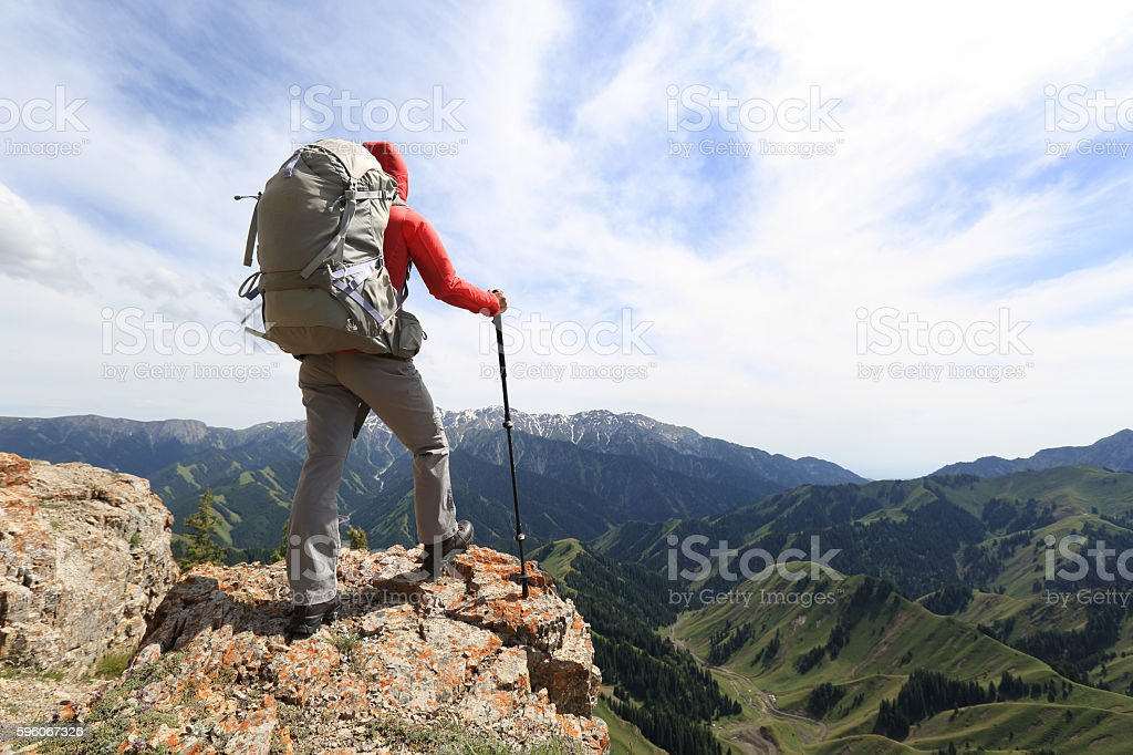 successful woman backpacker enjoy the view on mountain peak cliff royalty-free stock photo