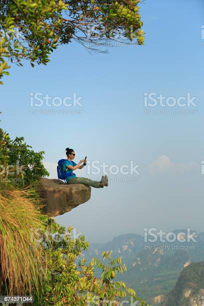 Successful woman hiker taking photo with smartphone on mountain peak picture id674371044?b=1&k=6&m=674371044&s=612x612&h=l 2vkxflbhe6rxwf7 iok ujats8qa dp7mxeyogrrg=
