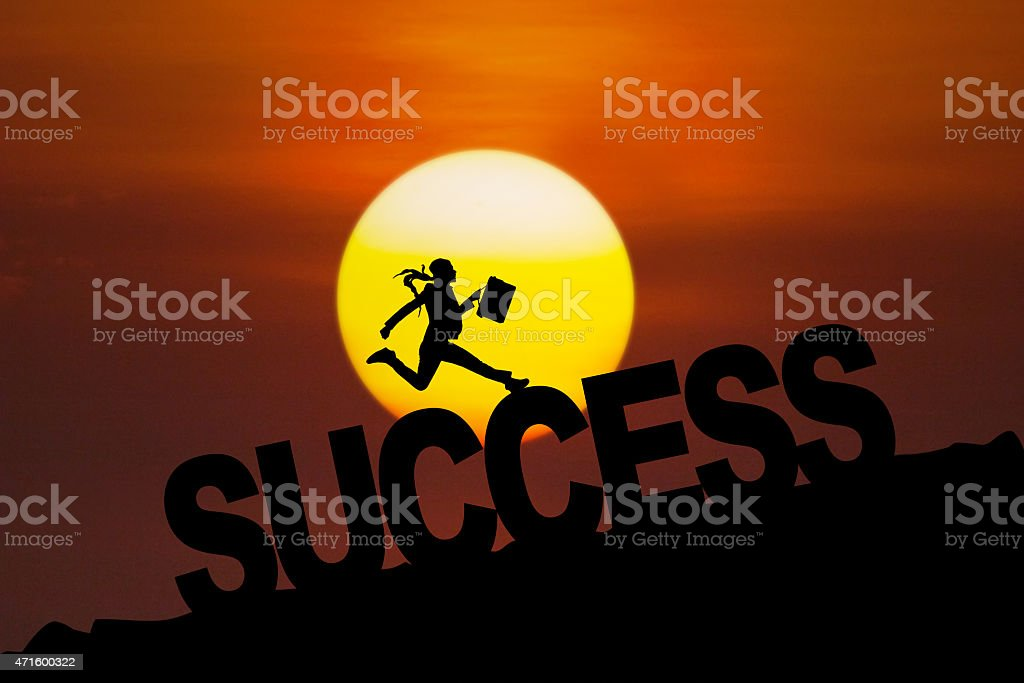 Successful woman jumping at sunset time stock photo