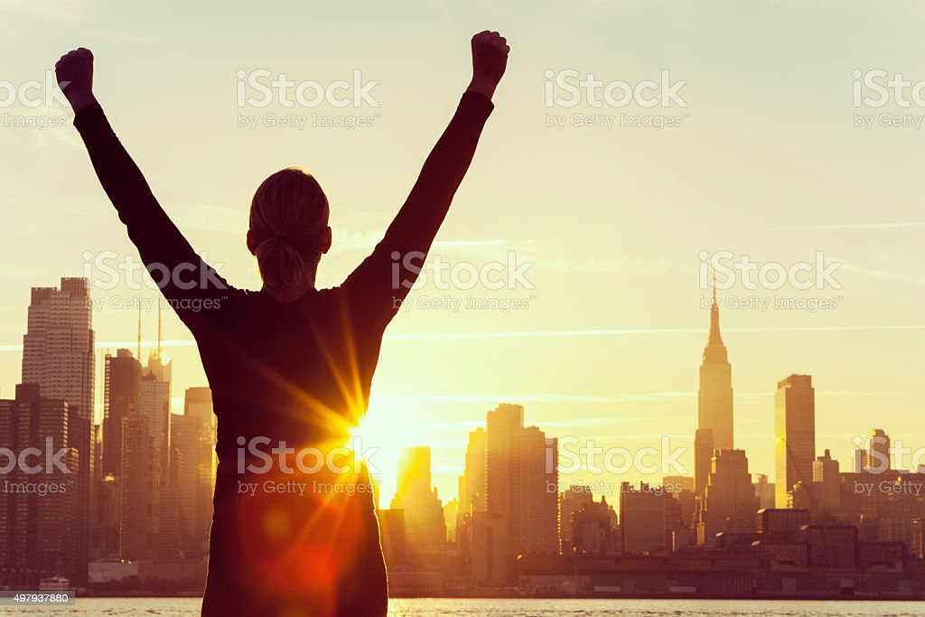 Successful Woman Sunrise New York City Skyline stock photo