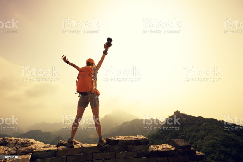successful woman tourist on top of mountain enjoy the view royalty-free stock photo