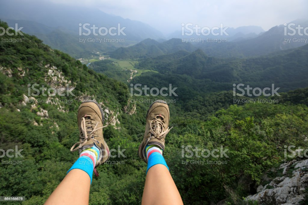 successful woman tourist sit on top of mountain enjoy the view royalty-free stock photo