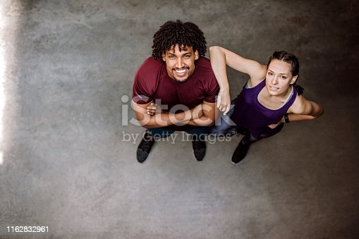 Attractive woman and handsome Afro man in sport clothing, from above