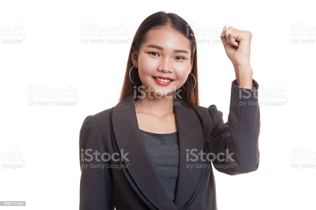 Successful  young Asian woman hold fist up. royalty-free stock photo