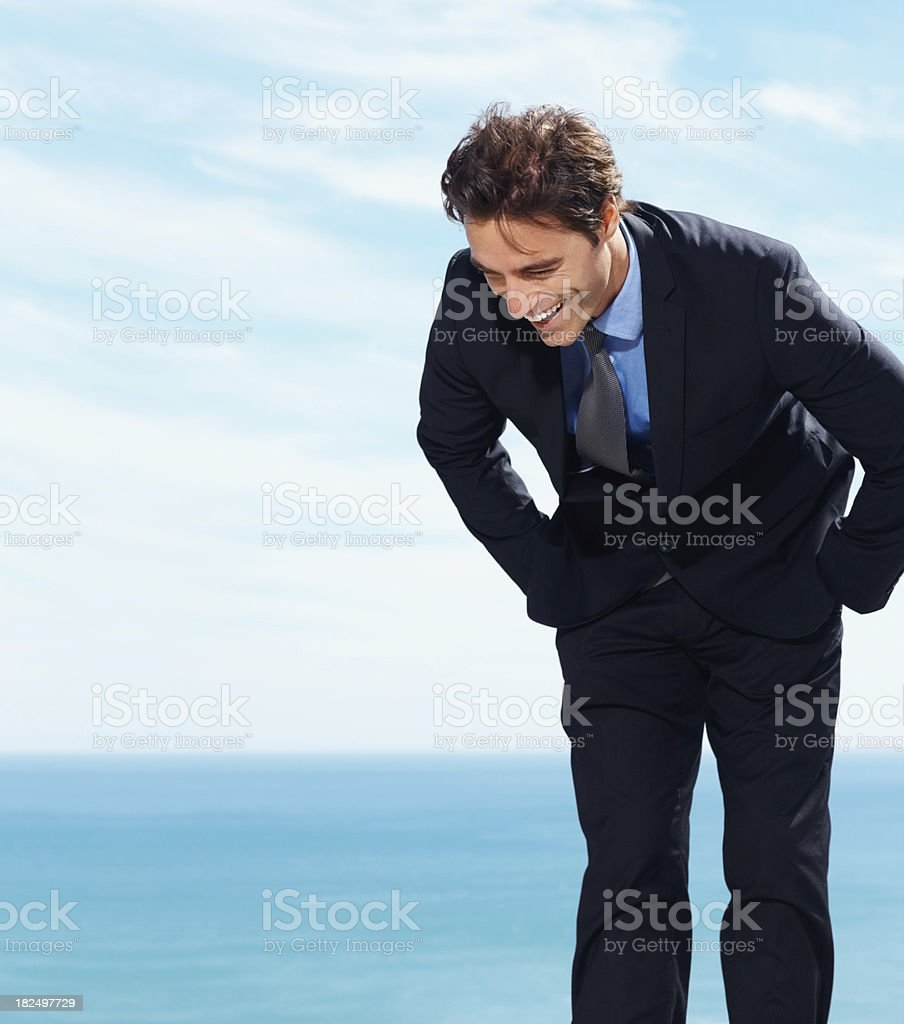 Successful young business adult laughing by the sea royalty-free stock photo