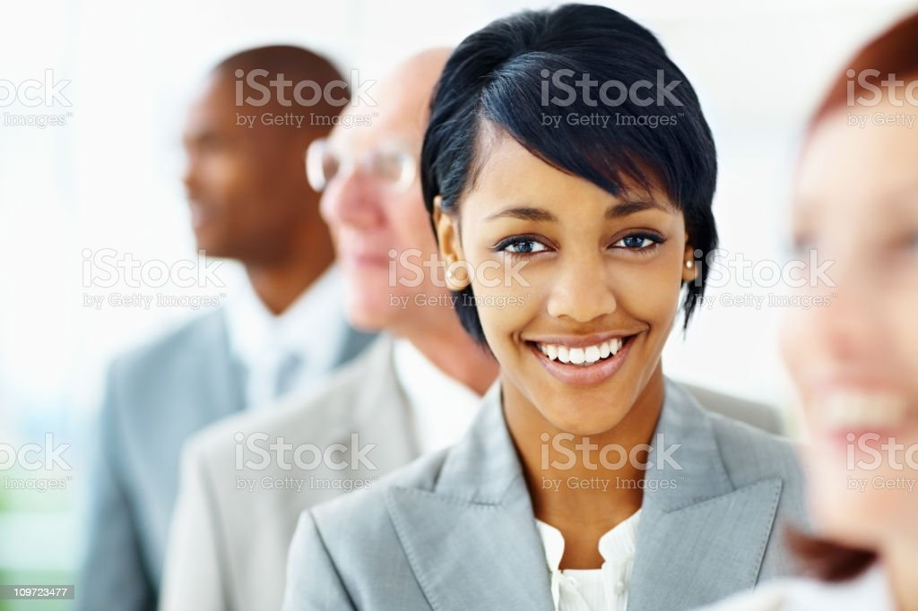 Successful young business woman standing with her blur team royalty-free stock photo