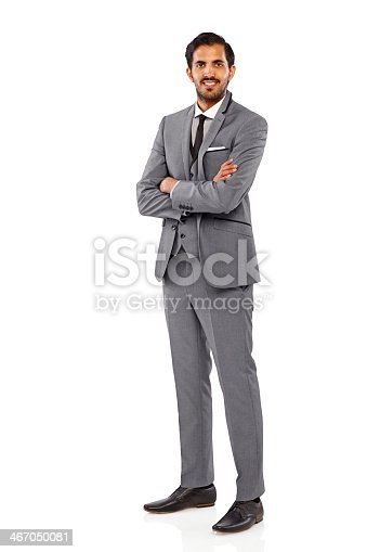 Full length portrait of successful young businessman standing with his arms crossed over white background