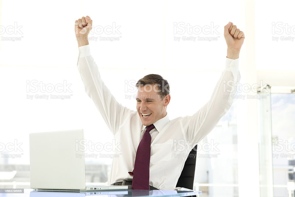 Successful young businessman using laptop royalty-free stock photo
