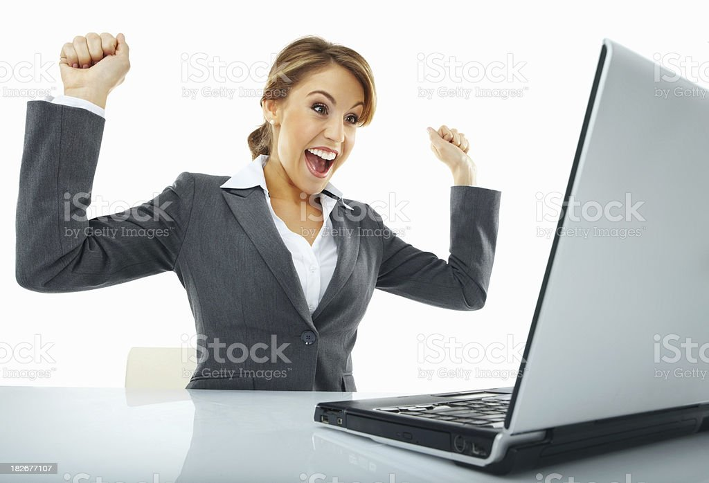 Successful young businesswoman looking at laptop royalty-free stock photo