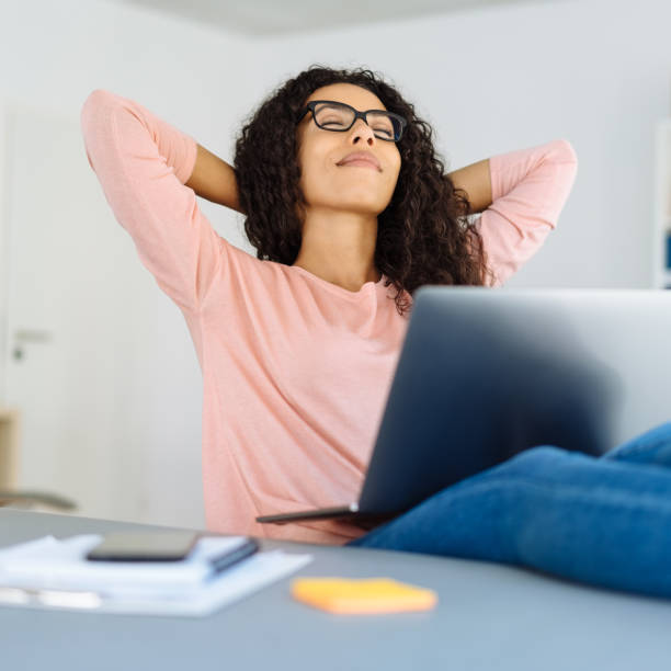 Successful young businesswoman relaxing stock photo