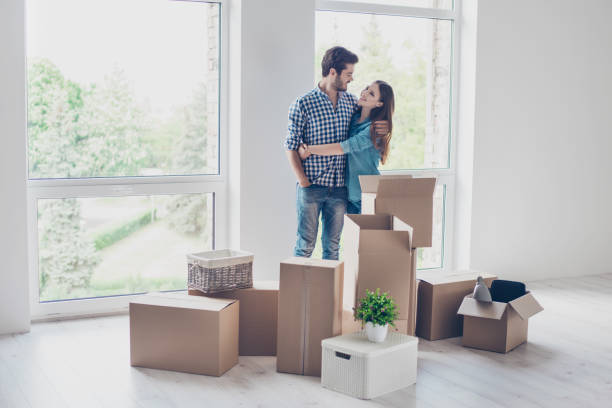 Successful young couple is moving to new nice place and embracing picture id939604954?b=1&k=6&m=939604954&s=612x612&w=0&h=v0eyoarbqmnwo9aexc3mzcmmyg7a66xac gjjxv0mwa=