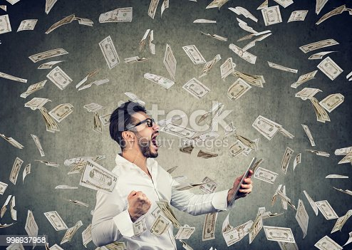 istock Successful young man using tablet building online business earning money 996937958