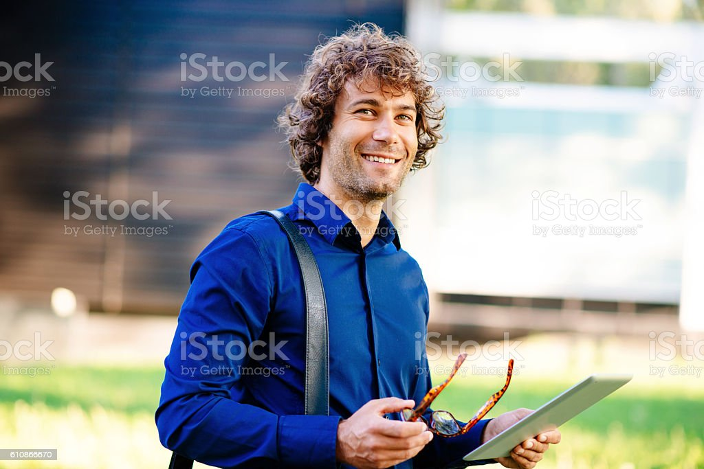 Successful young man with digital tablet stock photo