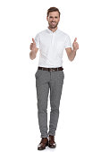 istock successful young smart casual man makes the ok sign 1131988886