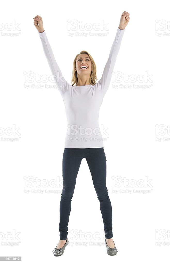 Successful Young Woman With Arms Raised stock photo