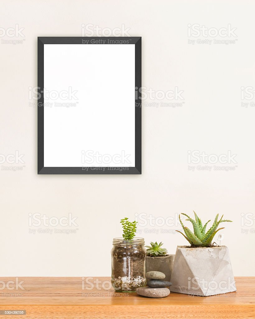 Succulent and frame mockup stock photo