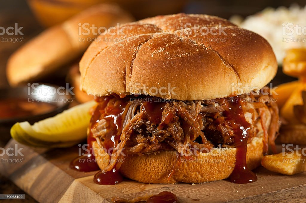 Succulent barbecue pulled pork in a bun and sauce  stock photo