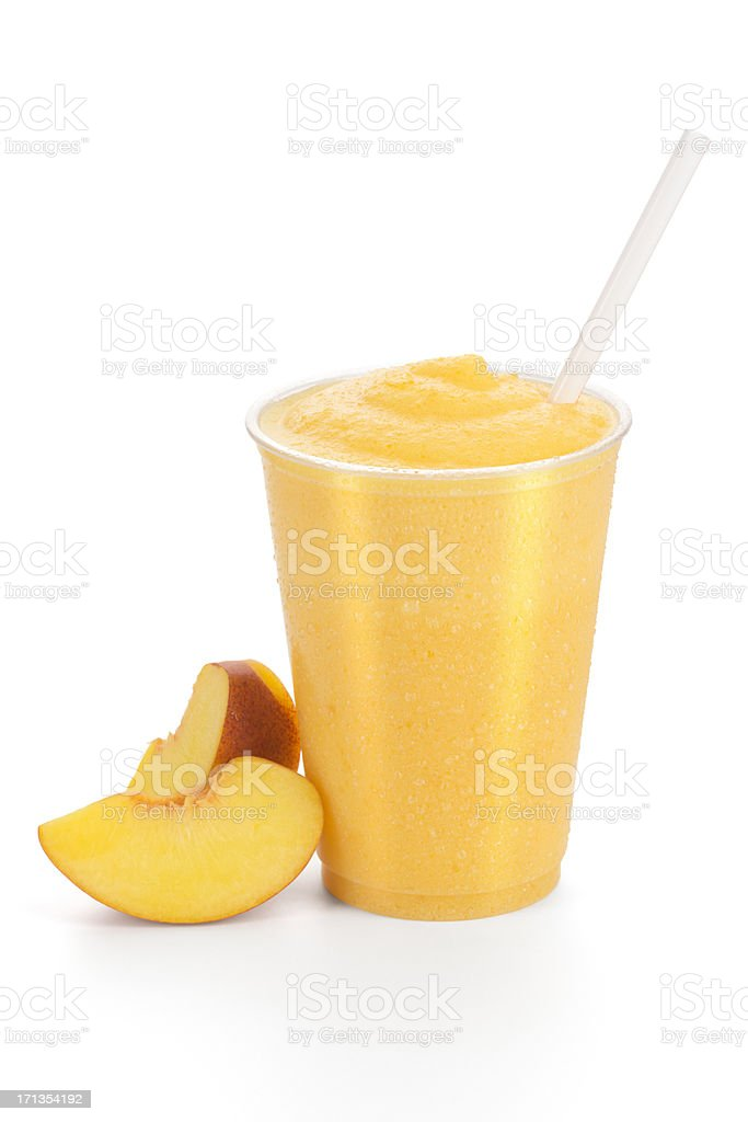 Succulent peach smoothie with peaches on the side stock photo