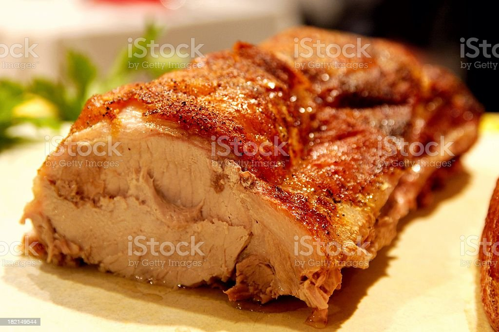 A succulent roast sitting on a cutting board ready to eat stock photo
