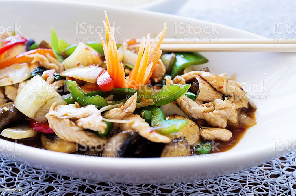 Succulent Thai chicken dish with bell peppers basil and mushrooms royalty-free stock photo