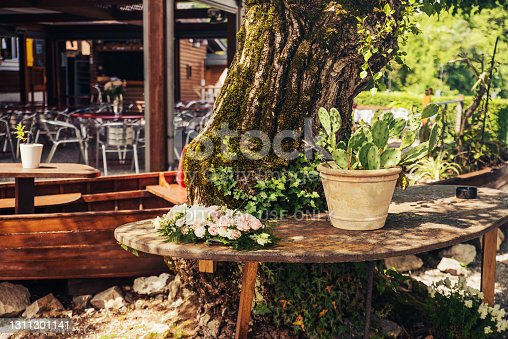 istock Succulents vase and roses on open air restaurant table 1311301141
