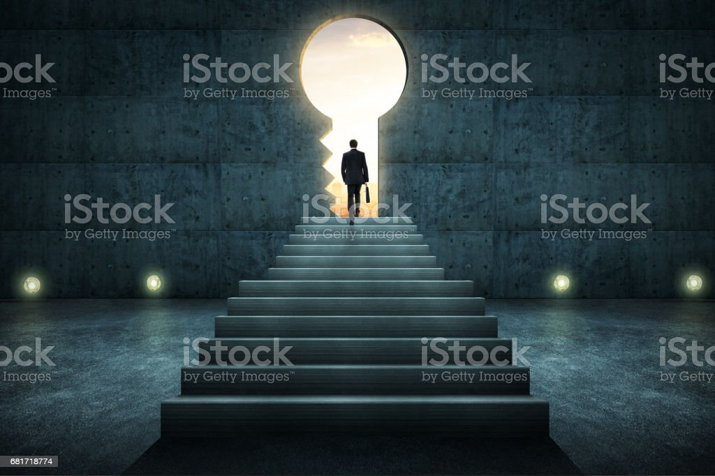 Sucess businessman climbing on stair against conrete wall with key hole door ,sunrise scene city skyline outdoor view . stock photo