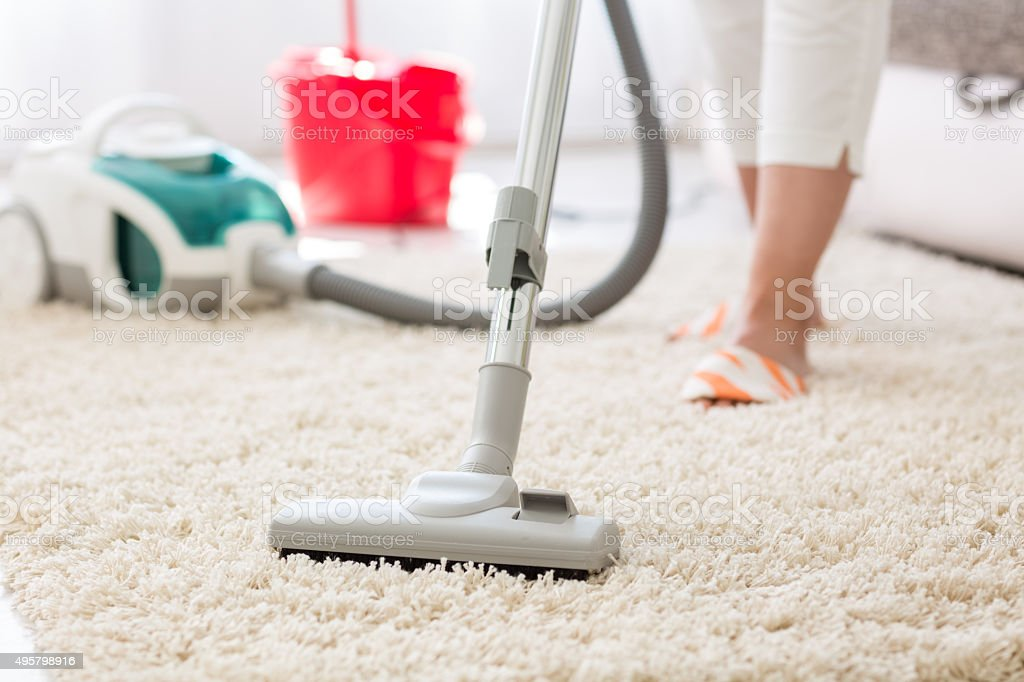 Suction carpet Suction grey carpet cleaning with vacuum cleaner 2015 Stock Photo
