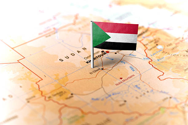 sudan pinned on the map with flag - sudan stock photos and pictures