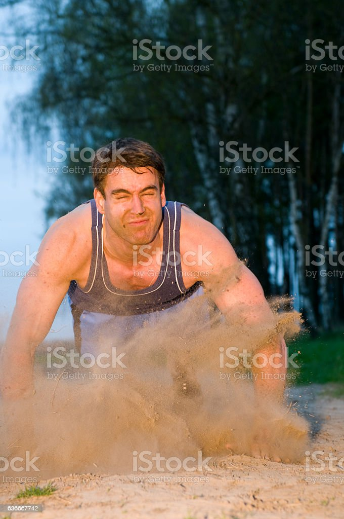 sudden fall in the dust stock photo