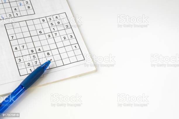Sudoku puzzle book with blue pen against white background space for picture id917325816?b=1&k=6&m=917325816&s=612x612&h=zkmb8yub7zsnbeldbu8fb4xxlg9rwynurs3jxz mwvg=