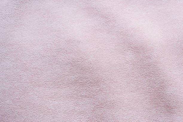 Suede is artificial. Light pink suede fabric close-up. Velvet texture background stock photo